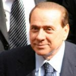 Jail term for Berlusconi as PM calls for calm