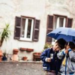 """""""These kids were in front of a church in Ostia Antica; they were walking around following the cats. It started to rain and one of their mothers came over and gave them an umbrella.""""Photo: Humans of Rome/Marco Massa"""