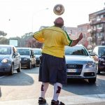 """""""Sometimes I get on a random train; it's like travelling to another country. I love how unpredictable it can be; like seeing this Italian guy in a Brazil shirt.""""Photo: Humans of Rome/Marco Massa"""