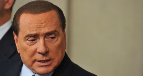 Berlusconi pledges to stay in politics if ousted