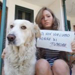 """""""We don't want to die of cancer,"""" says Rosalba, 21, from Orta di Atella pictured here with her puppy.Photo: Noi Ci Mettiamo La Faccia/Facebook"""