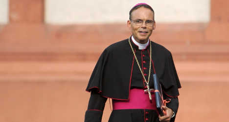 Pope chat prompts 'bling bishop' to take time out