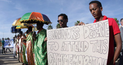 Protests mar ceremony for shipwreck dead