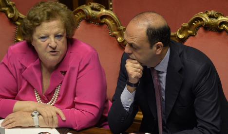 Italy minister fights power abuse allegations