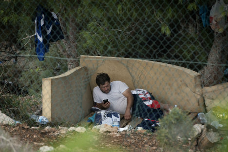 Migrants sew lips together in Rome protest