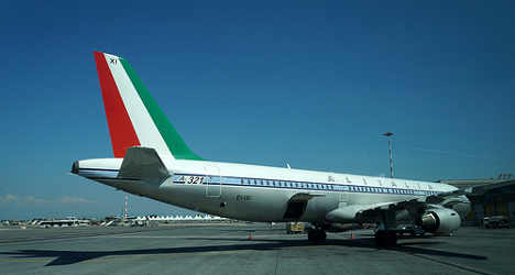 Italian post service chips in for troubled Alitalia