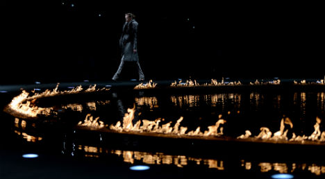 Cavalli scorches Milan with ring of fire catwalk