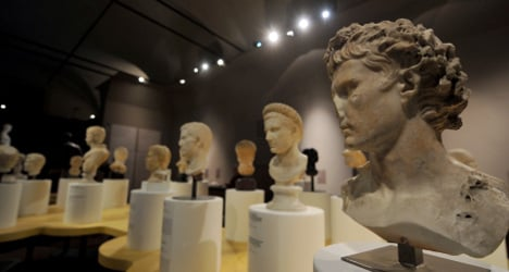 Italy reclaims looted treasures from Swiss