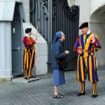 """<b>Swiss Guard</b> They may dress like colourful jesters, but Swiss Guards are actually described by the Vatican as """"warriors"""" and """"defenders of the Church's freedom"""". They flocked to Rome to protect the Catholic Church from foreign fighters in the early 16th century and have stayed at the Vatican's gate ever since. Photo: <a href=""""http://www.shutterstock.com/pic-179822933/stock-photo-rome-italy-april-photo-of-papal-swiss-guard-talking-with-a-woman-in-front-of-the.html?src=UxT5zVip7dUxGACOboE-jQ-1-0"""">Shutterstock</a>"""