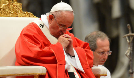 Tired Pope Francis back at work with a smile