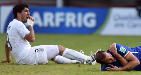 Suarez risks World Cup ban after Italy bite