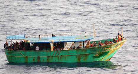 Sixty migrants 'stabbed to death by traffickers'