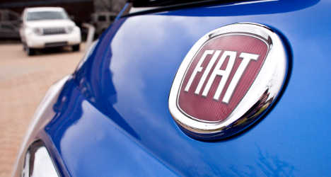 Fiat profits plunge after US tax charges