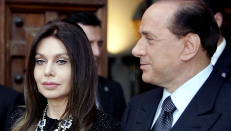 Berlusconi's ex-wife sees alimony cut by third