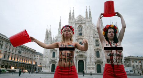 Putin targeted by topless protest at Milan summit