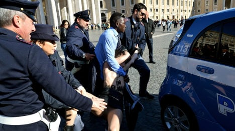 Topless feminists target 'political' Pope