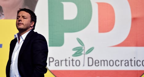 Poll win for Renzi but voters fire warning shots