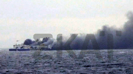 One dead as burning ferry rescue continues