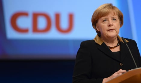 Merkel casts doubt on France, Italy reforms