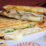 """<b>Panini</b> In the UK, a """"panini"""" is a grilled sandwich. Ask for """"panini"""" in Italy, however, and you'll get several ordinary sandwiches (""""panini"""" is simply the plural of sandwich). """"Instead, you'd need to ask to have it toasted (""""tostato""""),"""" advises Cesarato.  Sandwiches in Italy also tend to be simpler. """"They don't contain butter, for a start. Normally, a sandwich is just a roll filled with cheese, cold cuts and – more recently – a helping of grilled vegetables."""" If you fancy a more British-style sandwich, she suggests ordering a """"tramezzino"""" - a triangular sandwich made with soft white bread with the crusts removed.Photo: Kitchen Life of a Navy Wife/Flickr"""