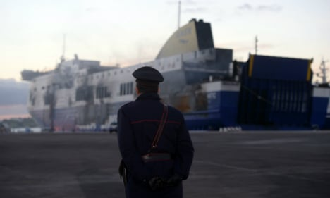 Charred ferry searched for dead passengers