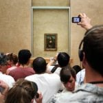 """Argue the celebrated Mona Lisa painting should stay at the Louvre museum in Paris, rather than be displayed in Florence.Photo: <a href=""""http://www.shutterstock.com/pic-149769374/stock-photo-paris-july-a-crowd-of-visitors-take-photos-of-leonardo-davinci-s-mona-lisa-at-the-louvre.html?src=0b8D0JkATyhPBo1L0sgYcg-1-2"""">Shutterstoc"""