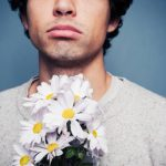 """Tell an admirer you appreciate their friendship but don't want to date them.Photo: <a href=""""http://www.shutterstock.com/pic-167161316/stock-photo-sad-and-rejected-man-with-a-bouquet-of-flowers.html?src=v3wKT9fl17CWDBtWoC63LA-1-2"""">Shutterstock</a>"""