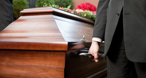 Horror as 'heavy' man's coffin splits at funeral