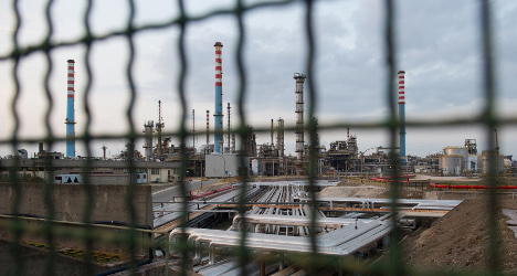 Italy's steel workers risk cancer or hunger