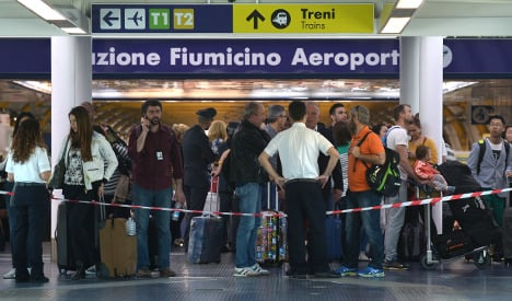 Chaos after fire in Rome airport terminal