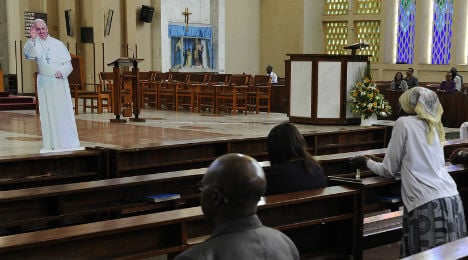 Pope to defy risks with open-top Africa tour