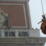 """Irene Rizzi performs the """"Angel flight"""" or """"Flight of the dove"""" from the bell tower of Saint Mark's square (Piazza San Marco) to officially launch the Venice Carnival on January 31st. Photo: AFP"""