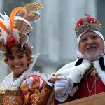 """Irene Rizzi poses with an actor dressed as a """"Doge"""" (lord) after performing the """"Angel flight"""" or """"Flight of the dove"""" from the bell tower of Saint Mark's square (Piazza San Marco) to officially launch the Venice Carnival on January 31th 2016. Photo: AFP"""
