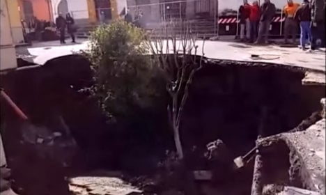 Huge sinkhole swallows car and trees in Italian square