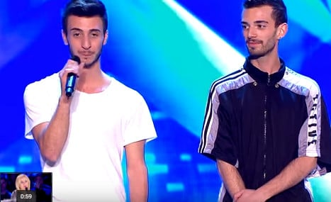 Italian gay couple come out to their dads on live TV