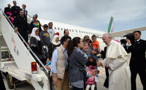 Pope's refugee families settle into Roman life