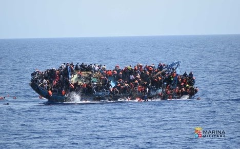Striking pictures capture moment of migrant shipwreck