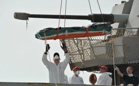 Rescuers recover 15 dead migrants off Italy