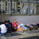 Record numbers of migrants leave Milan's centres struggling