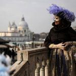 Masks and period costume are staples of the event.Photo: Marco Bertorello/AFP