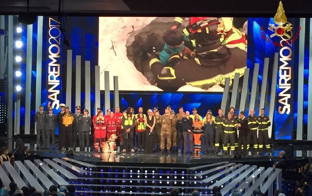 Italy's music festival honours firefighters - and rescue dog