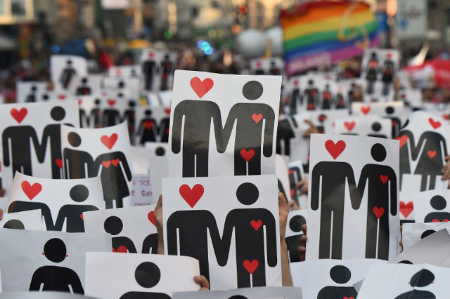 Italy's anti-discrimination head quits over gay sex club scandal