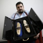 An Italian shoemaker has made the world's first 24-carat gold shoes