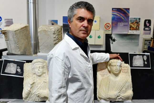 Two statues rescued from Isis are back in Syria after Italy restoration