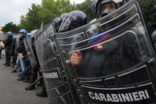 Police officers injured in clashes outside Italy G7 meet