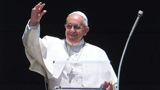 Pope Francis congratulates 'honorary canon' Macron on winning French presidency
