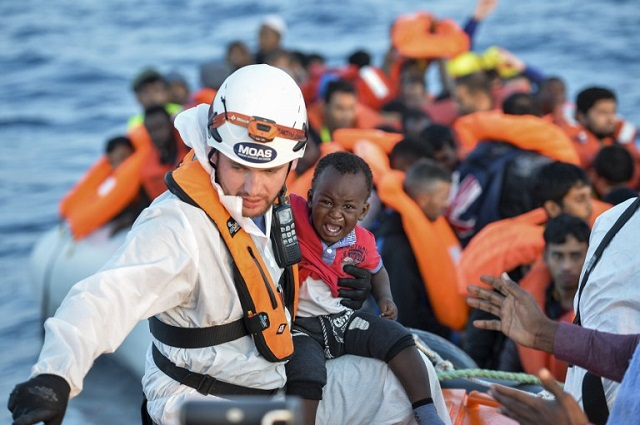 Italy's PM hails migrant rescuers amid probe into trafficking links