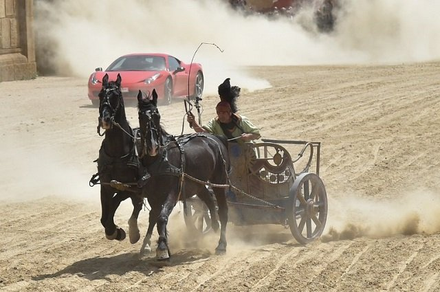 A horse-drawn chariot raced a Ferrari on a dirt track in Rome