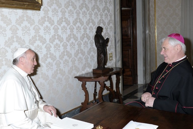 Pope dismisses doctrine chief in turbulent week for Vatican