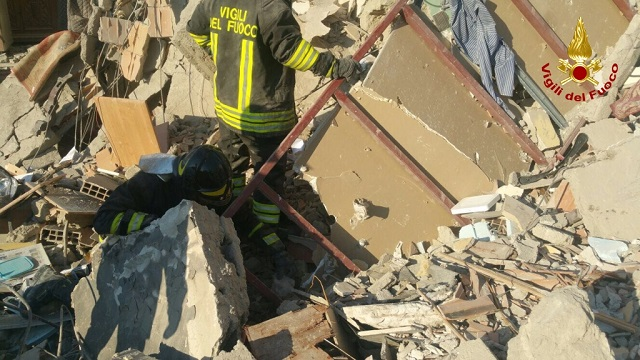 No signs of life as firefighters search for two families feared missing after building collapse